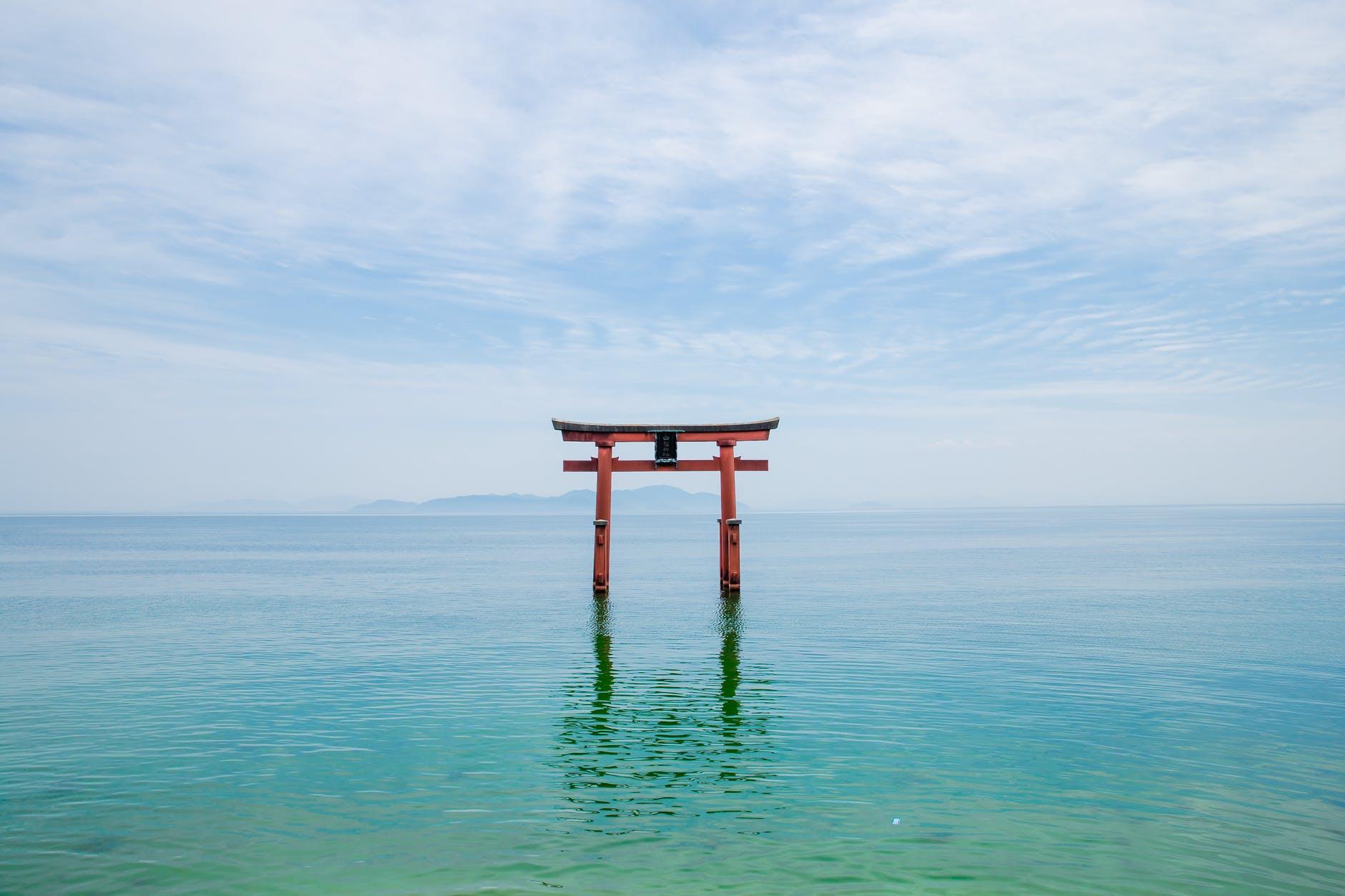 shinto shrine in blue lake in japan